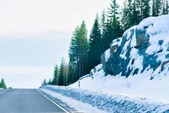 Winter road in Snow Forest at Cold Finland in Lapland. Winter road in a Snow Forest at Cold Finland in Lapland royalty free stock photography