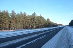 Winter road. The road in the snow near a forest Royalty Free Stock Images