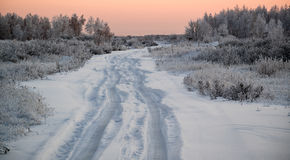 Winter road in snow. Snowy winter road early on a cold morning in the Urals in Russia Stock Image
