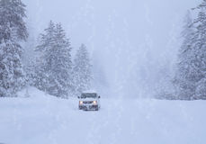 Winter road. Snowfall. Royalty Free Stock Image