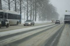 Winter Road snowing in winter season.  stock photo