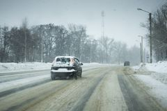 Winter Road snowing in winter season.  royalty free stock image