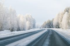 Winter road and Snowy Forest in Cold Finland. Of Lapland stock photography