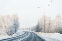 Winter road and a Snowy Forest of Cold Finland. Of Lapland royalty free stock image