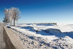 Winter road on a sunny frosty day Stock Photos