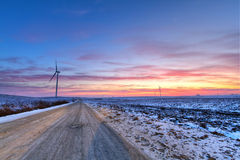 Winter road at sunset Stock Photo