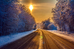Winter road in sunset Stock Photography