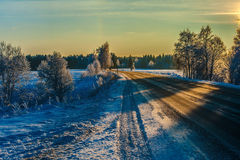 Winter road in sunset Royalty Free Stock Photo