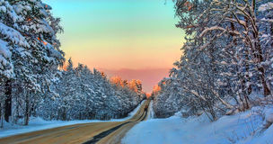 Winter road at sunset stock image