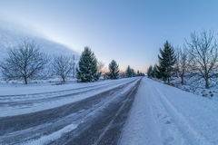 Winter road at sunset Stock Photography