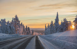 Winter road at sunset Royalty Free Stock Photos