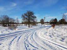 Winter road. Road in tge village during winter season Stock Photography