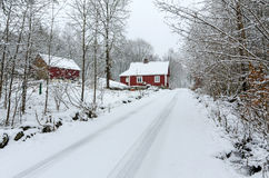 Winter road to Swedish village Royalty Free Stock Photo