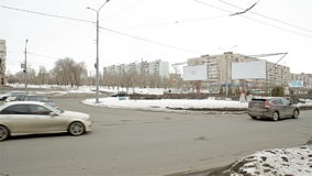 Winter road traffic in small russian city stock video footage