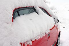 Winter in road traffic - A snowed car stock images