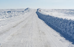 Winter road under blue sky Royalty Free Stock Photography