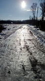 Winter road in village. Winter icy road in the countryside Royalty Free Stock Photos