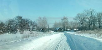 Winter road in village. Winter snowy rural road Stock Photography