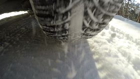Winter road, wheel view. In the back of the cars wheel, winter road stock video footage