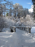 Winter road with a wooden bridge. Piding, Germany Royalty Free Stock Image