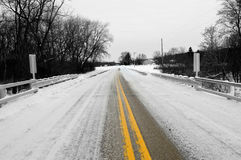Winter Road With Yellow Stripe Royalty Free Stock Photography