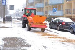 Tractor with an automatic trailer for spreading sand on roads. During winter, the roads are quite dangerous, because they are often sprinkled with sand, for stock images