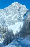 Winter rock with fresh snow and alpine road. Stock Image