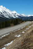 Winter rockies and highway Royalty Free Stock Photo
