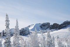 Winter Rocks. In Sheregesh mountains Royalty Free Stock Photo
