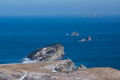 Winter rocks on the Pacific ocean Stock Image