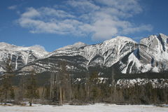 Winter in Rocky Mountains, Canada. Canadian Rocky Mountains give us feeling of real freedom, mostly untouched, wild and formed by power of nature Stock Photography