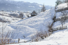Winter in a Romanian mountain village with the Carpathians Royalty Free Stock Image