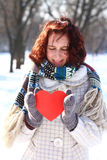 Winter romantic girl holding a heart outdoors Stock Images