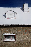 Winter roof with snow. Snowy roof through the winter Stock Photos