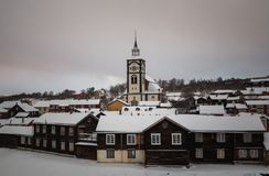 Winter in Roros, original mining town. Snow covered roofs of old royalty free stock photo