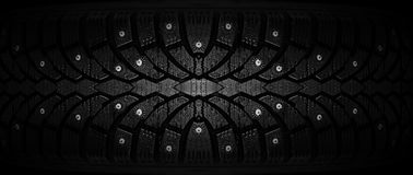 Winter rubber with spikes on a black background close-up. Royalty Free Stock Image
