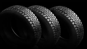 Winter rubber with spikes on a black background close-up. Stock Photo