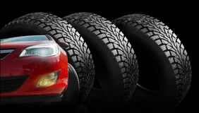 Winter rubber with spikes on a black background close-up. Royalty Free Stock Photo