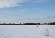 Winter Rugby. A large snowball on a snow-covered rugby pitch Royalty Free Stock Image