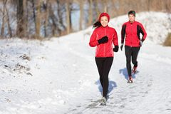 Winter running exercise couple stock images