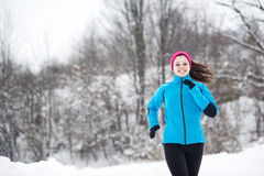 Winter running woman stock image