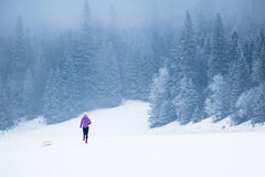 Winter running woman, jogging inspiration and motivation Stock Image