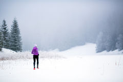 Winter running woman, jogging inspiration and motivation Stock Photos