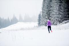 Winter running woman, jogging inspiration and motivation Stock Photo