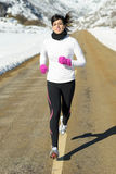 Winter running woman road Stock Image