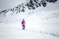 Winter running woman. Trail runner inspiration, sport and fitnes Royalty Free Stock Photography