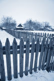Winter rural background with fence Stock Image