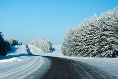 Winter rural highway in frosty day. Russia royalty free stock photo