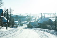 Winter rural highway in frosty day royalty free stock image