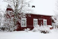 Winter rural house under snowfall Stock Photos